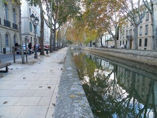 Reflections along the quay in Nimes
