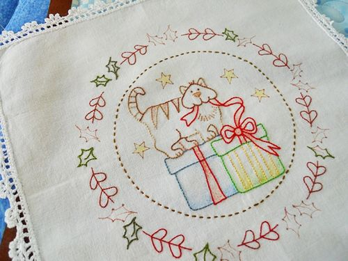 Xmas stitching on mums hankie (2)
